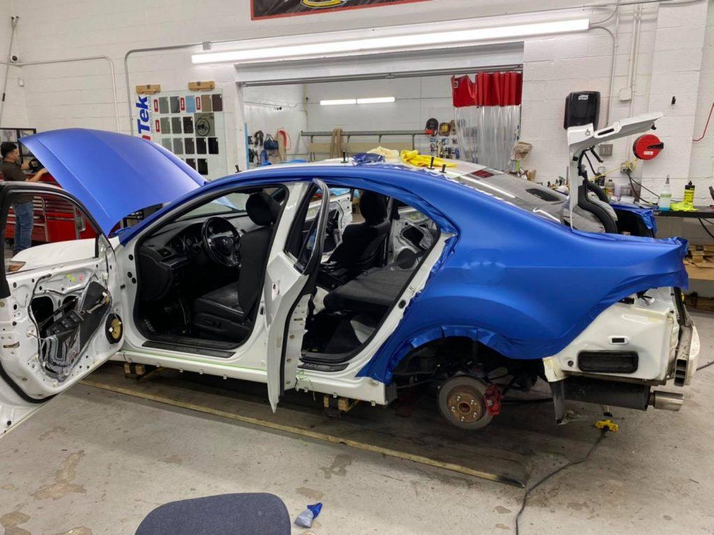 Acura TSX Full Wrap using Oracal 970 Midnight Blue Matte Metallic. Chrome delete...